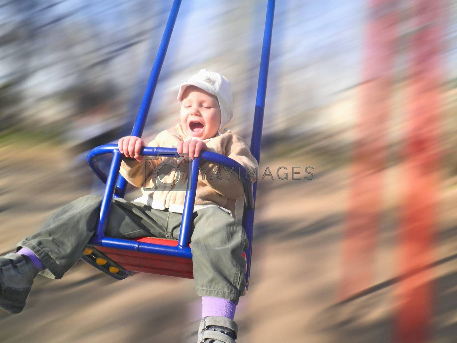 Enthusiastic kid on a swing