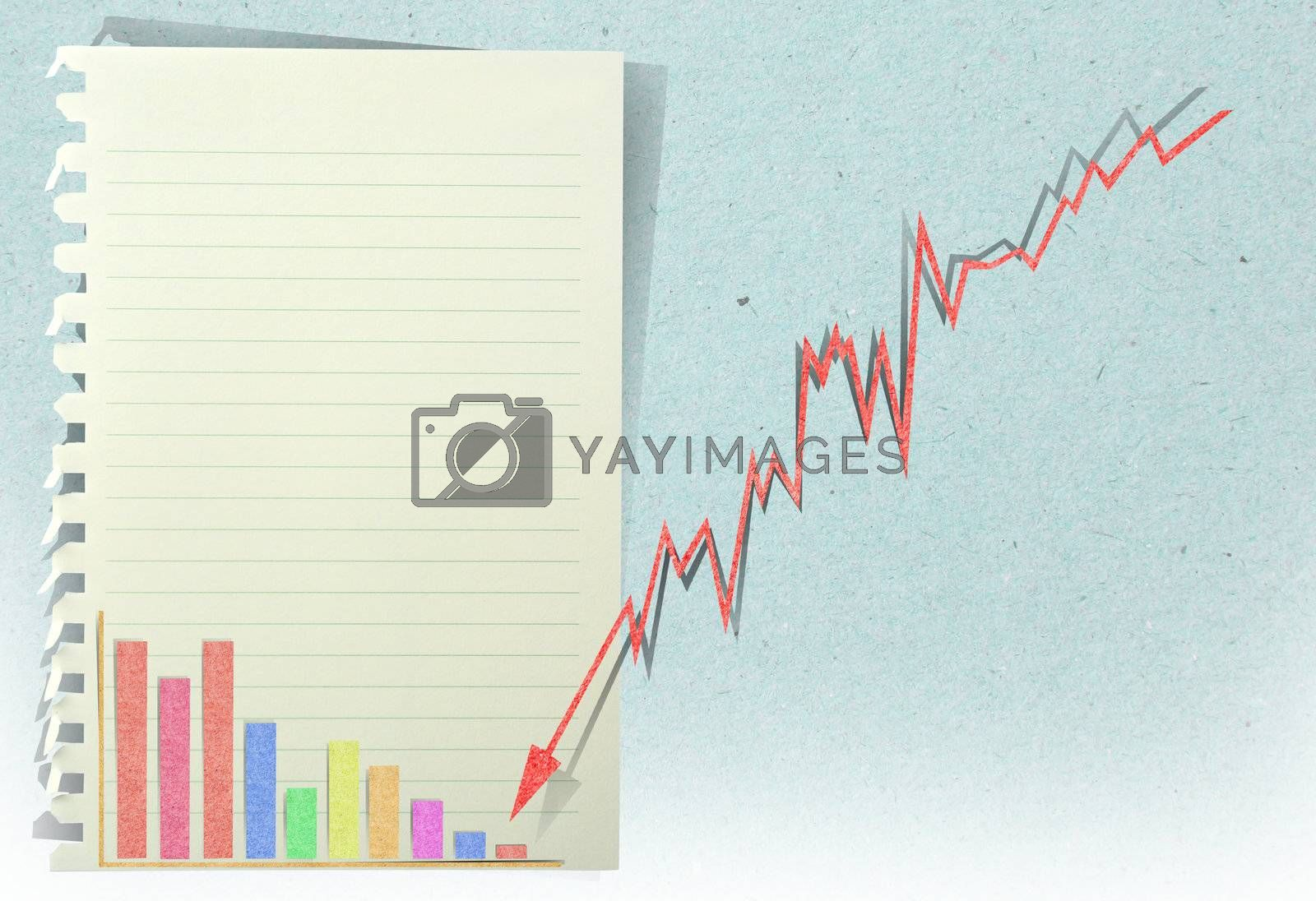 arrow graph going down with staple recycled paper craft stick