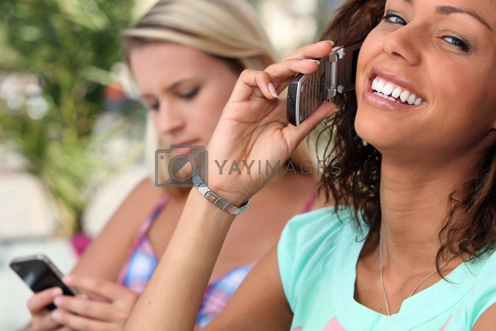 Young women embracing technology