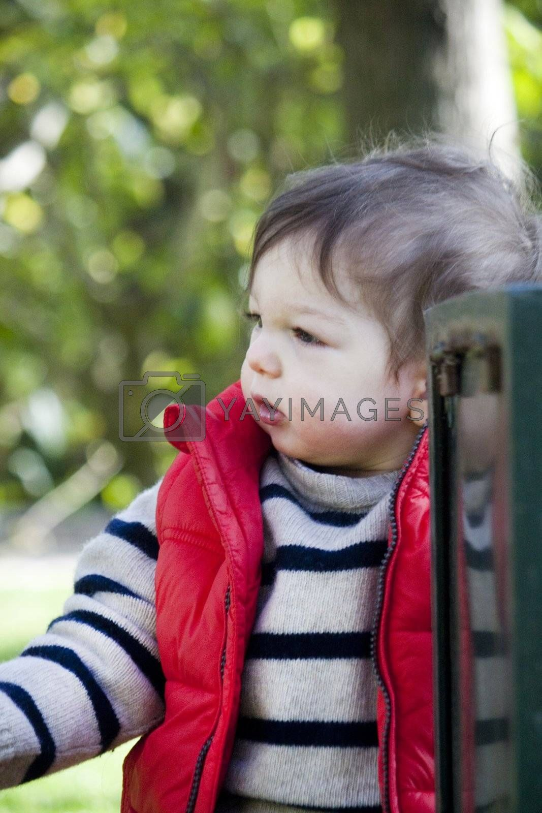 View of a young child on a urban park.