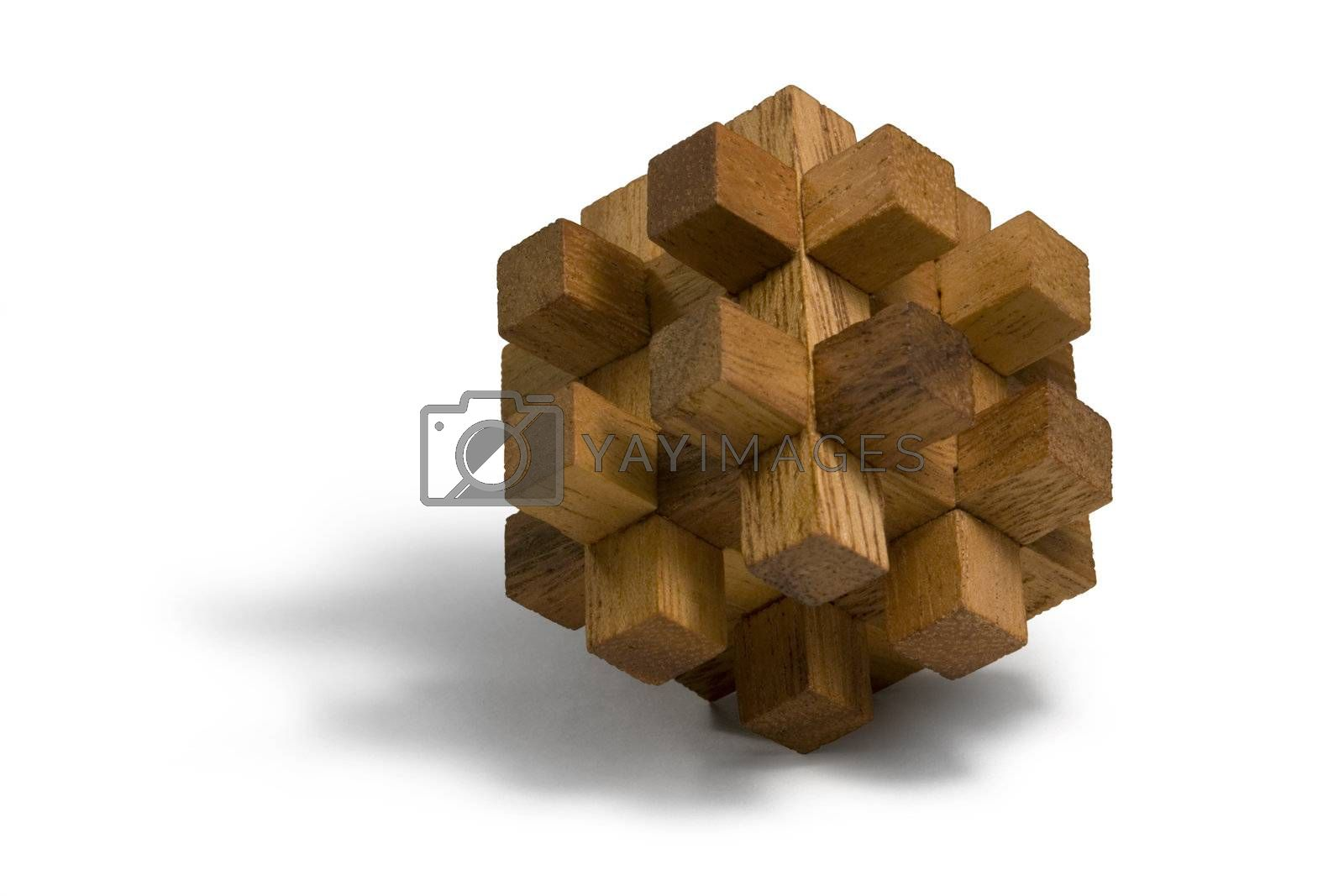 studio photography of a wooden 3D-puzzle in white back
