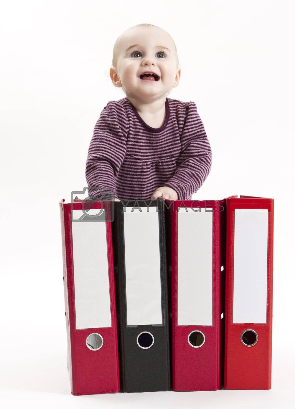 young child in light background with four ring files