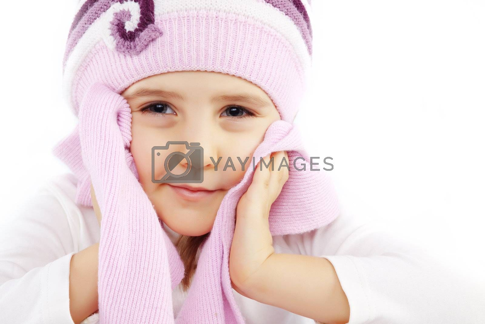 Portrait of lovely kid girl wearing winter clothing