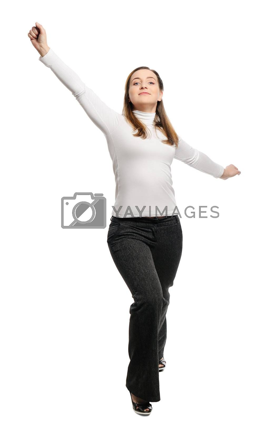 Beautiful young woman stands victory pose. Isolated on white background.