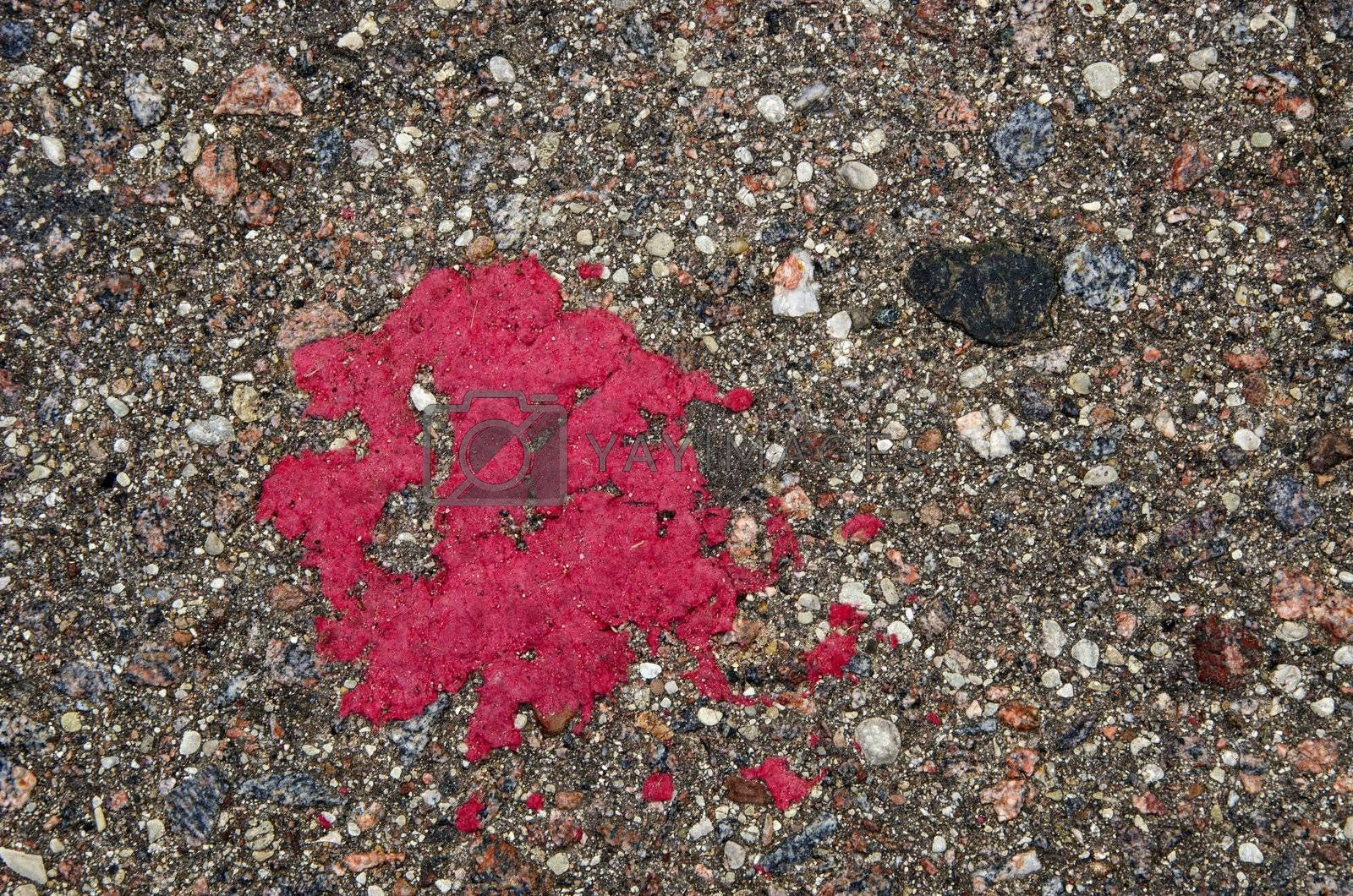 Background of grunge stone asphalt road closeup red paint stain.