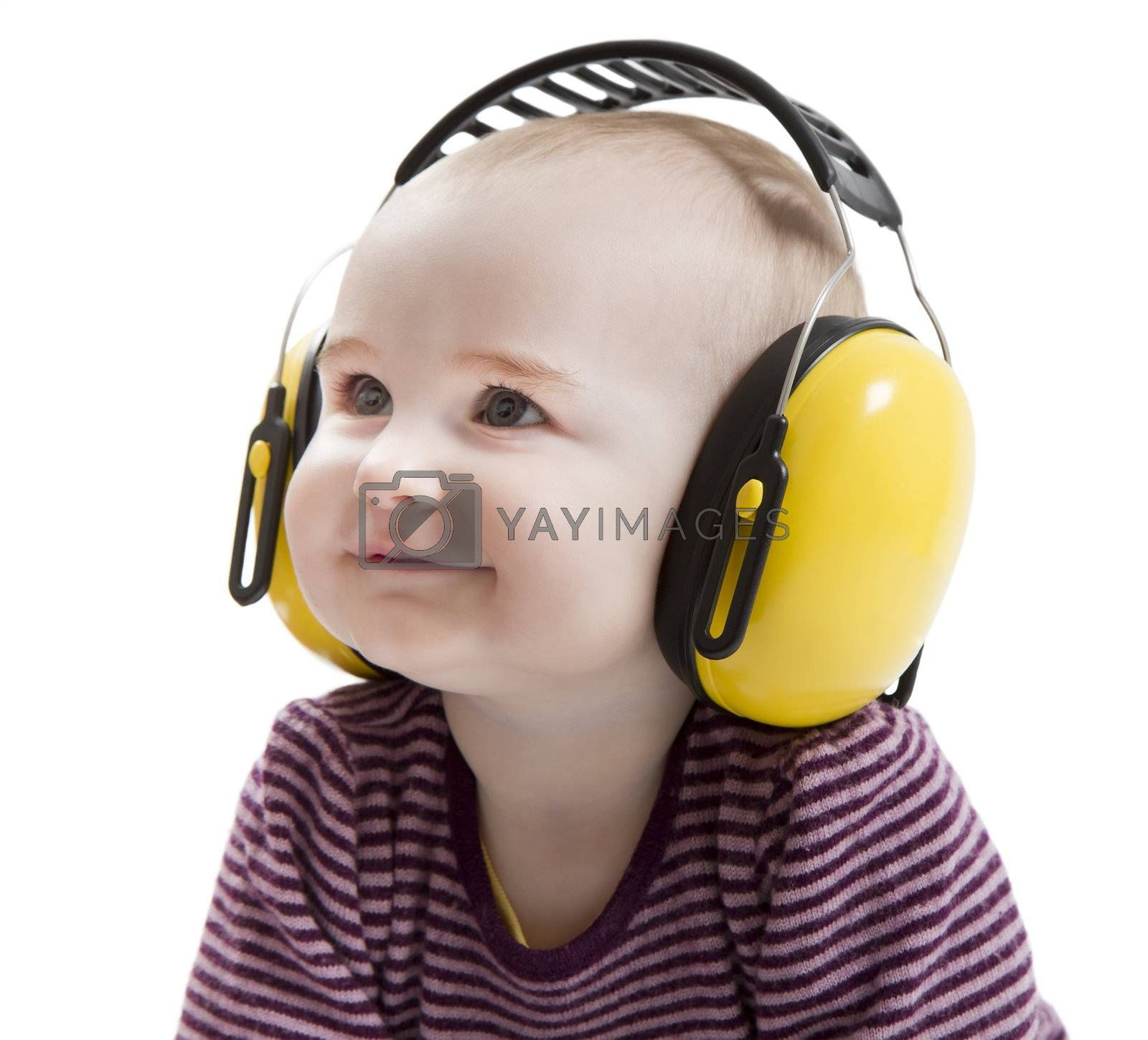 young child with yellow ear protector in light background. satisfied