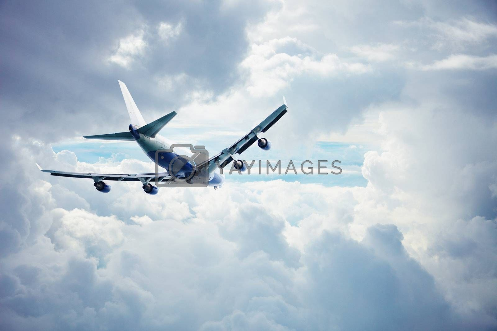 Passenger airliner flying through the thick clouds