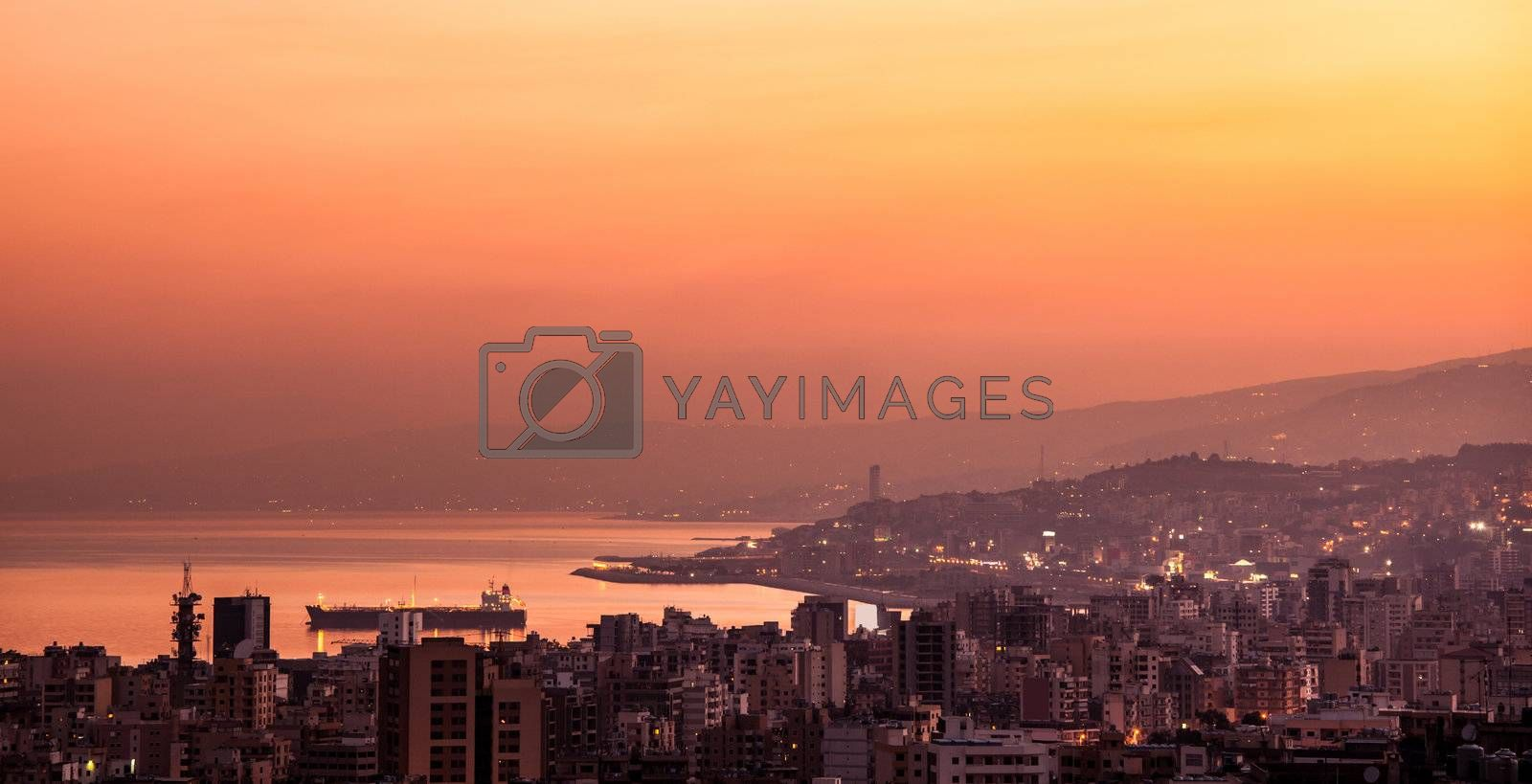 Beautiful red sunset on mountain city, evening cityscape, mediterranean sea, travel and tourism concept