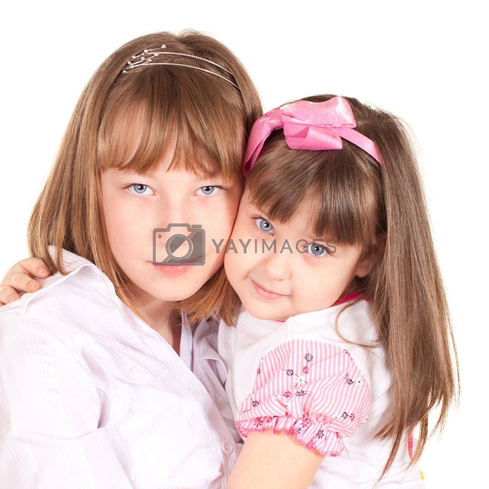 cute little sisters portrait, close up, isolated on white