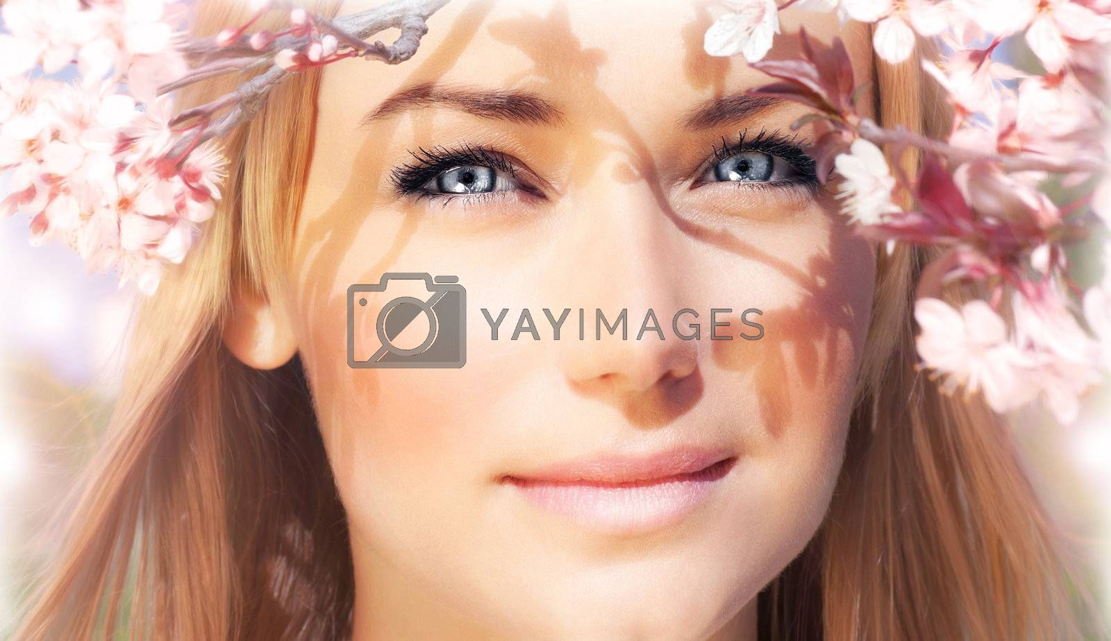 Sensual portrait of a spring woman, beautiful face, female enjoying cherry blossom, dreamy girl with pink fresh flowers outdoor, seasonal nature, tree branch and natural beauty
