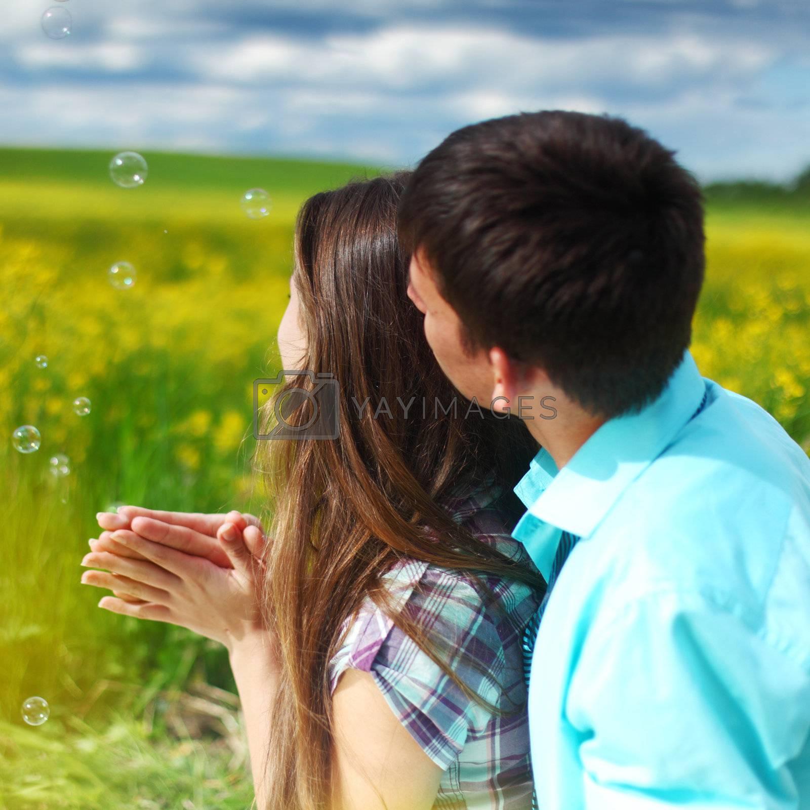 lovers hug on yellow flower field