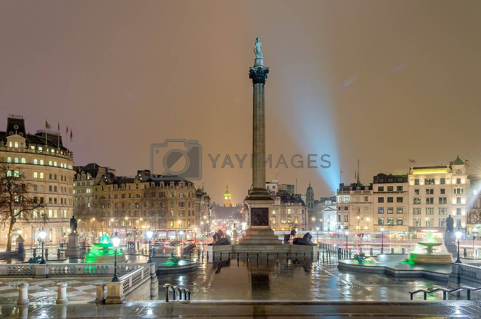 Trafalgar Square at night with the Big Ben on the background, London, UK