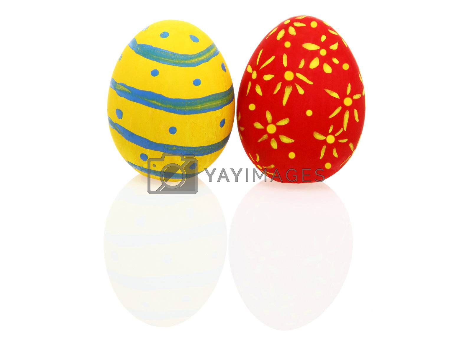 Colorful Easter eggs with reflection over white background