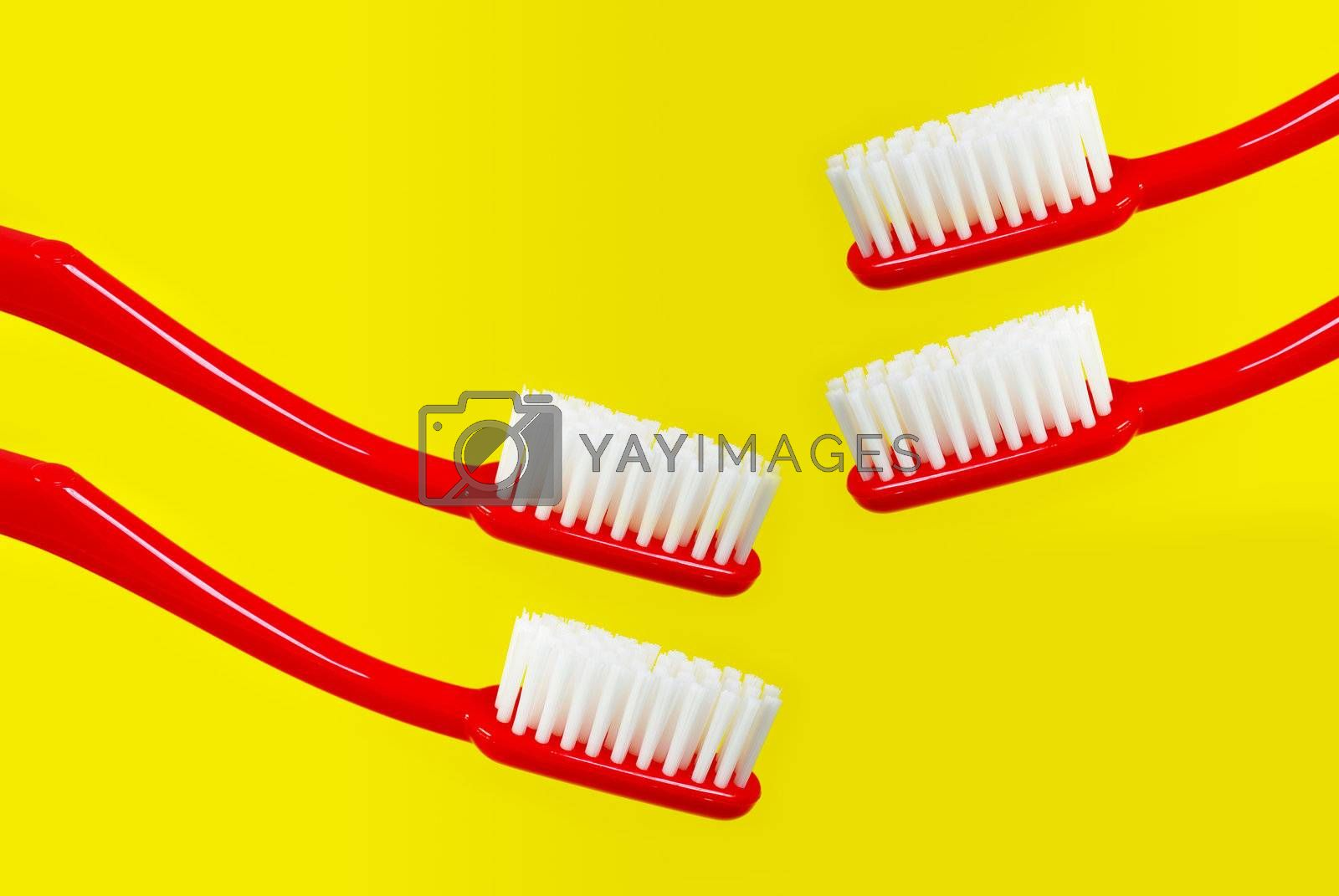 Red toothbrush on yellow background