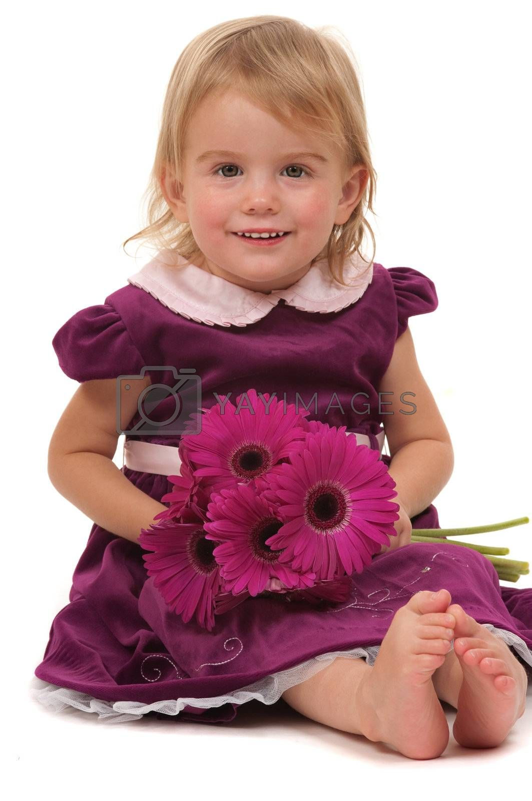 A very cute toddler with flowers