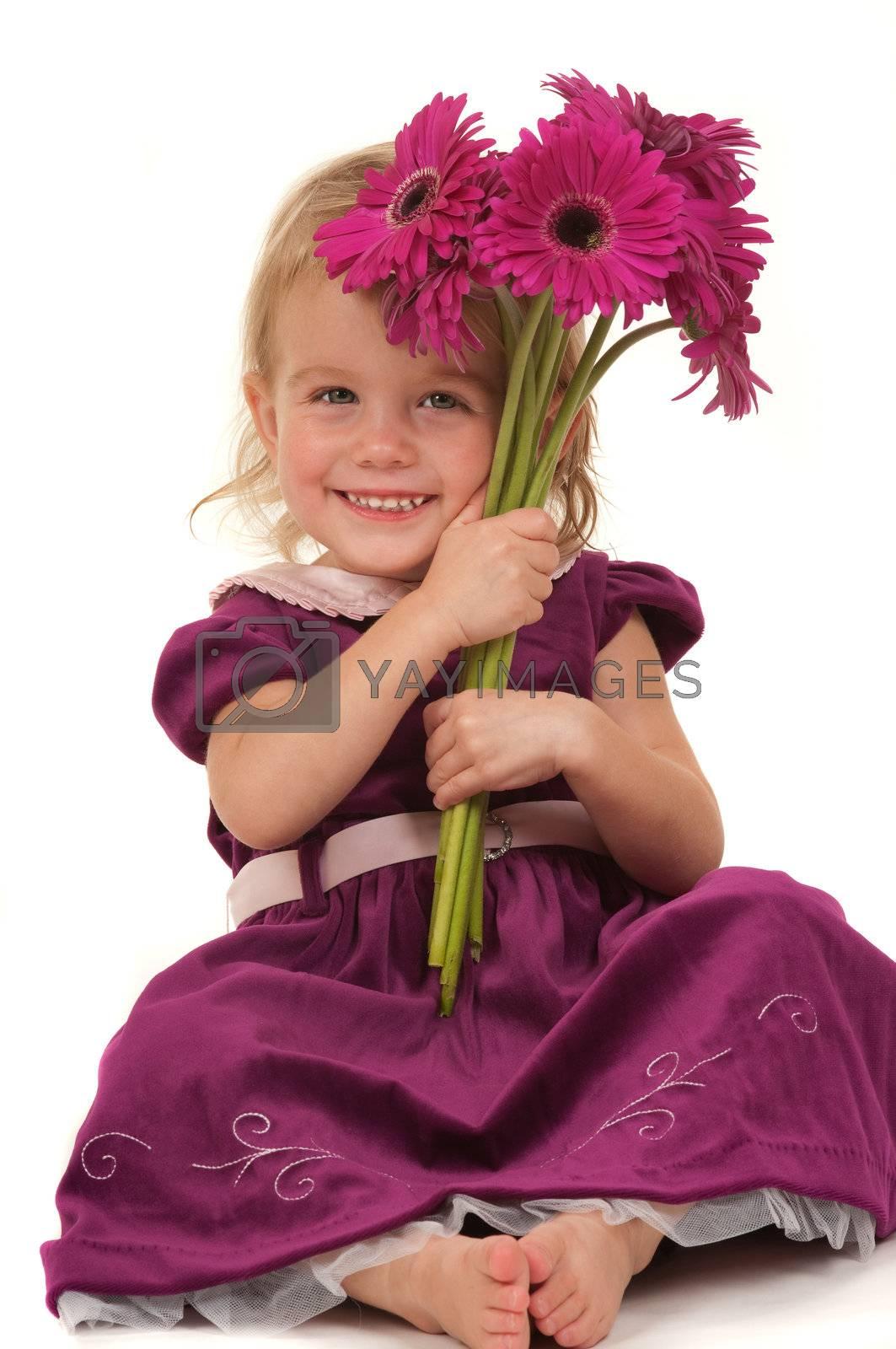 Beautiful little girl giving flowers