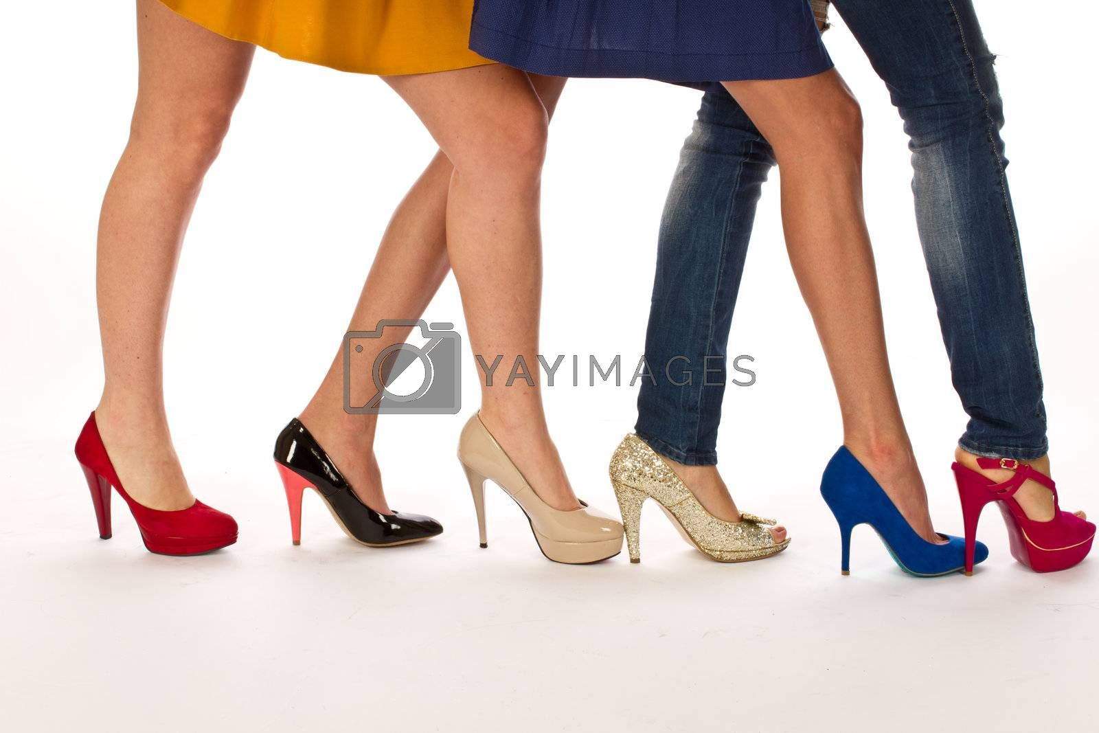 Female legs with different shoes, shoe shooping