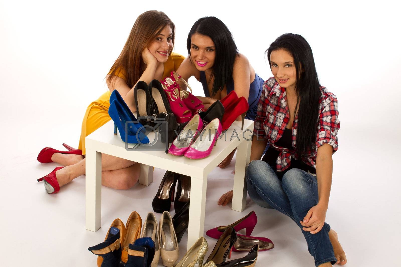 Three young beatufull woman with shoes, shoe shopping