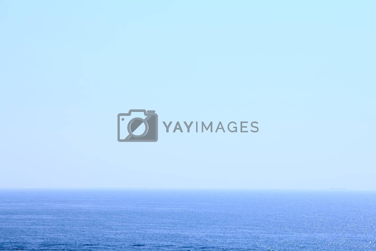 Blue sea under transparent clear sky