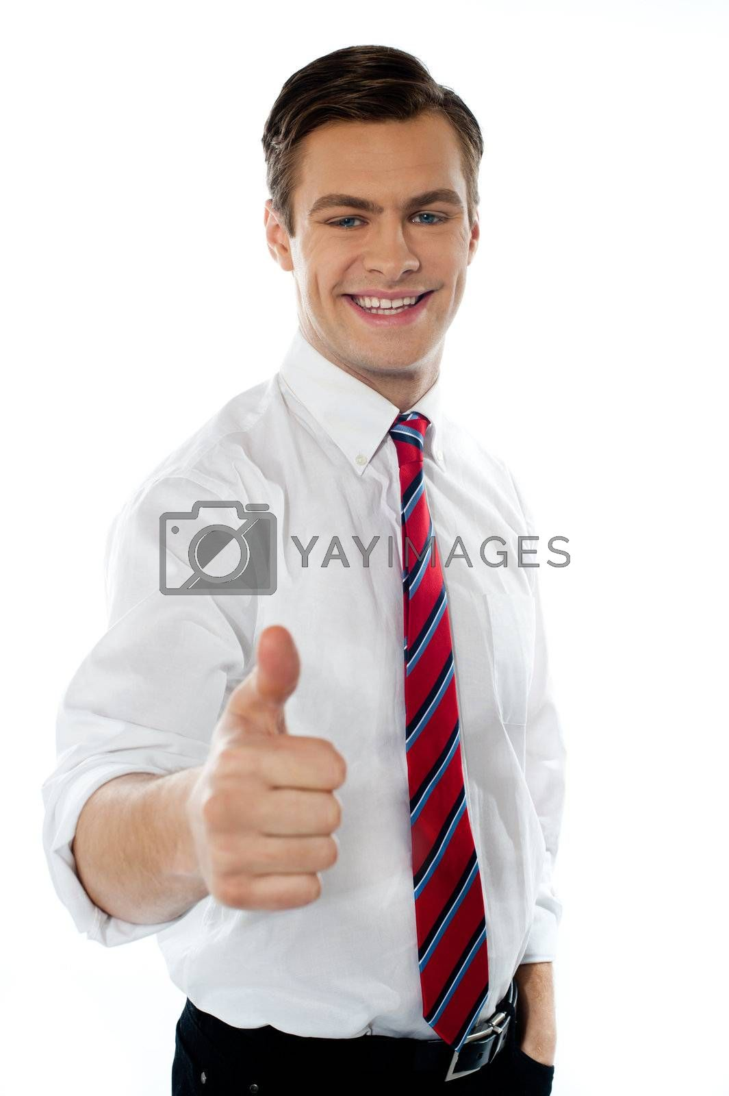 Young business executive showing thumbs up gesture isolated on white