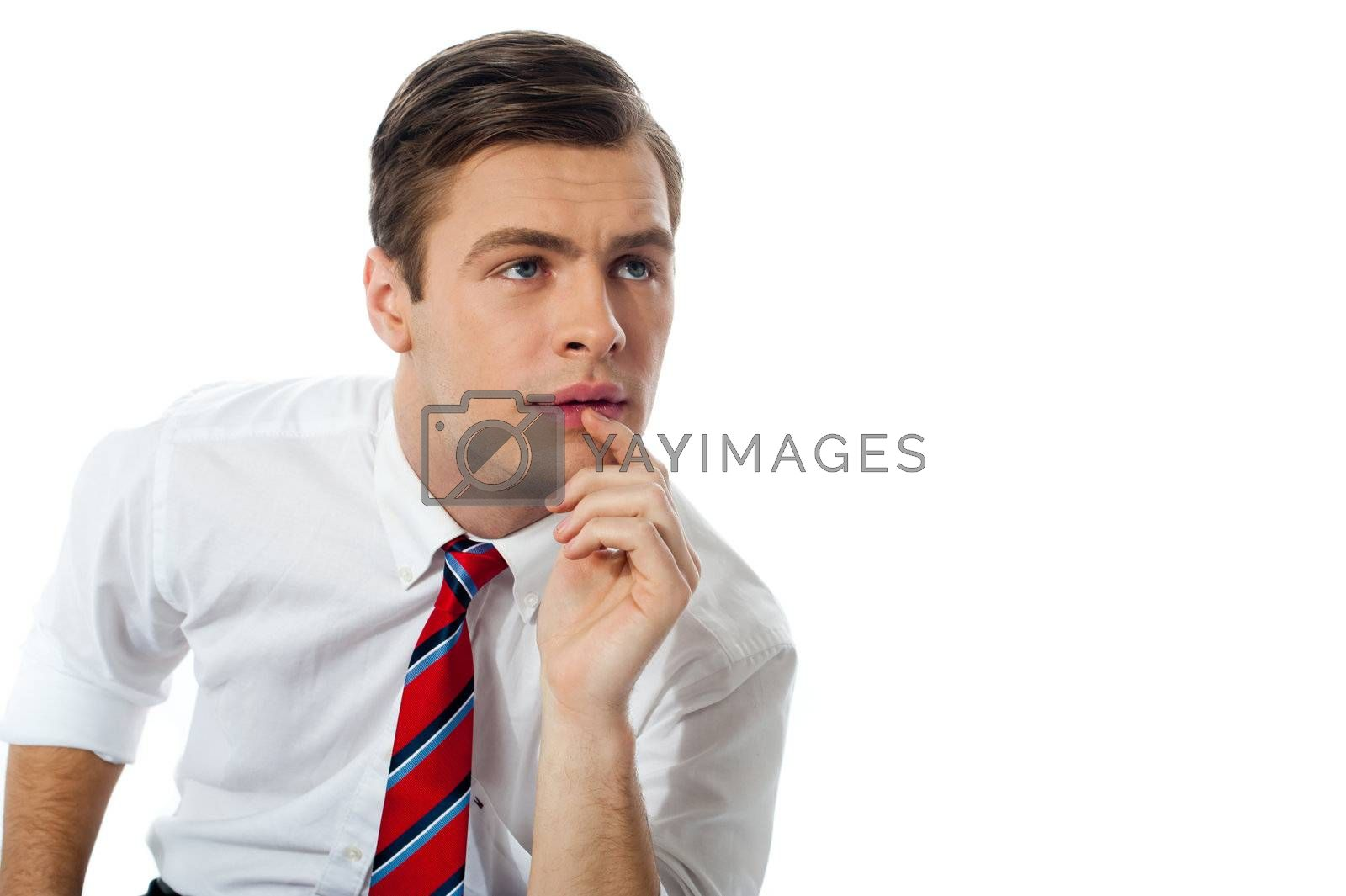 Thoughful business person looking up at something interesting