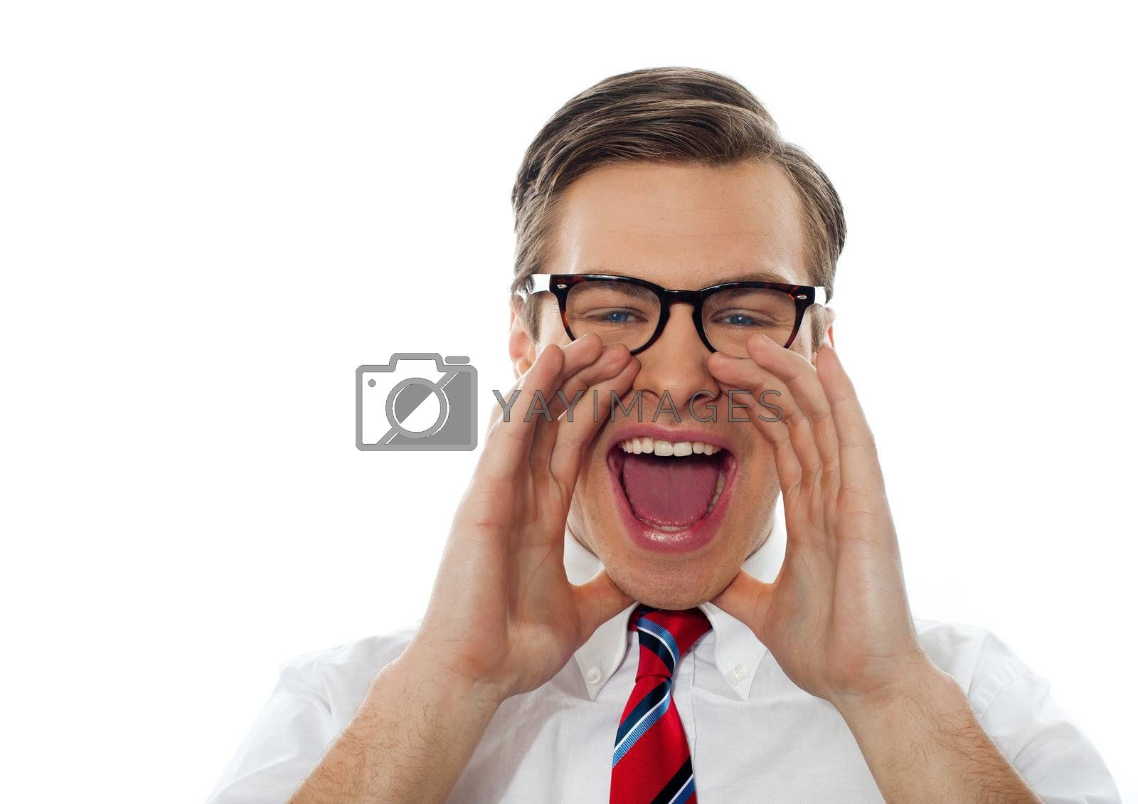 Closeup shot of a young man shouting loud by stockyimages