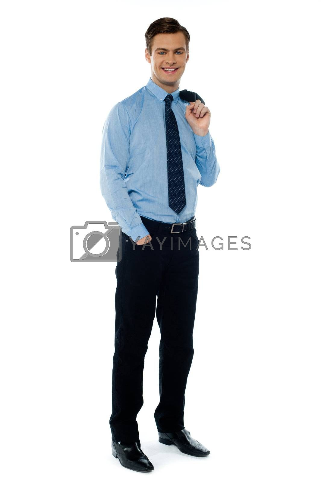 Portait of a professional businessman holding his coat and posing in style