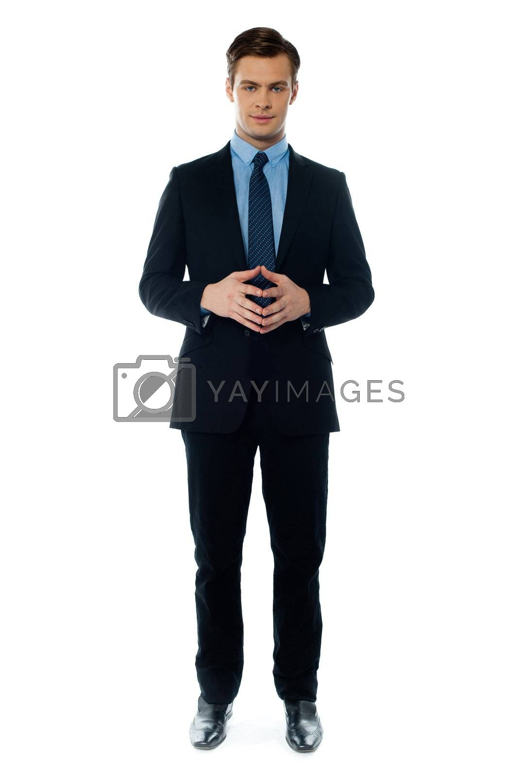 Confident executive standing in business suit isolated on white background