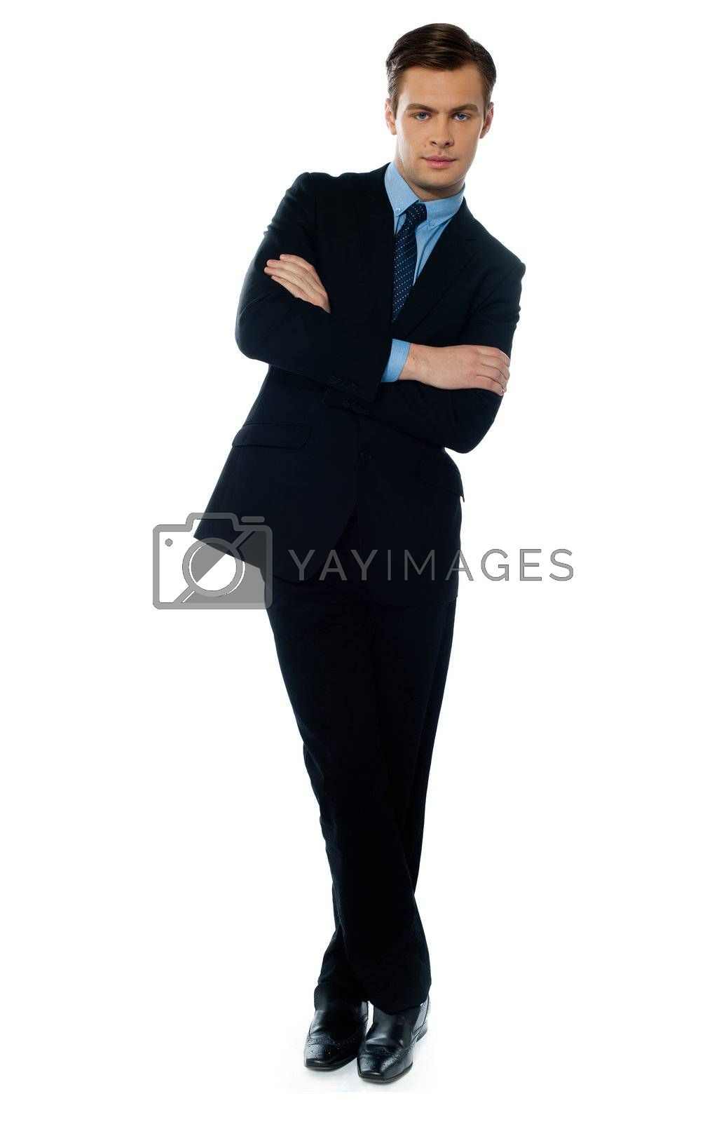 Young buisnessman tilting and smiling against white background