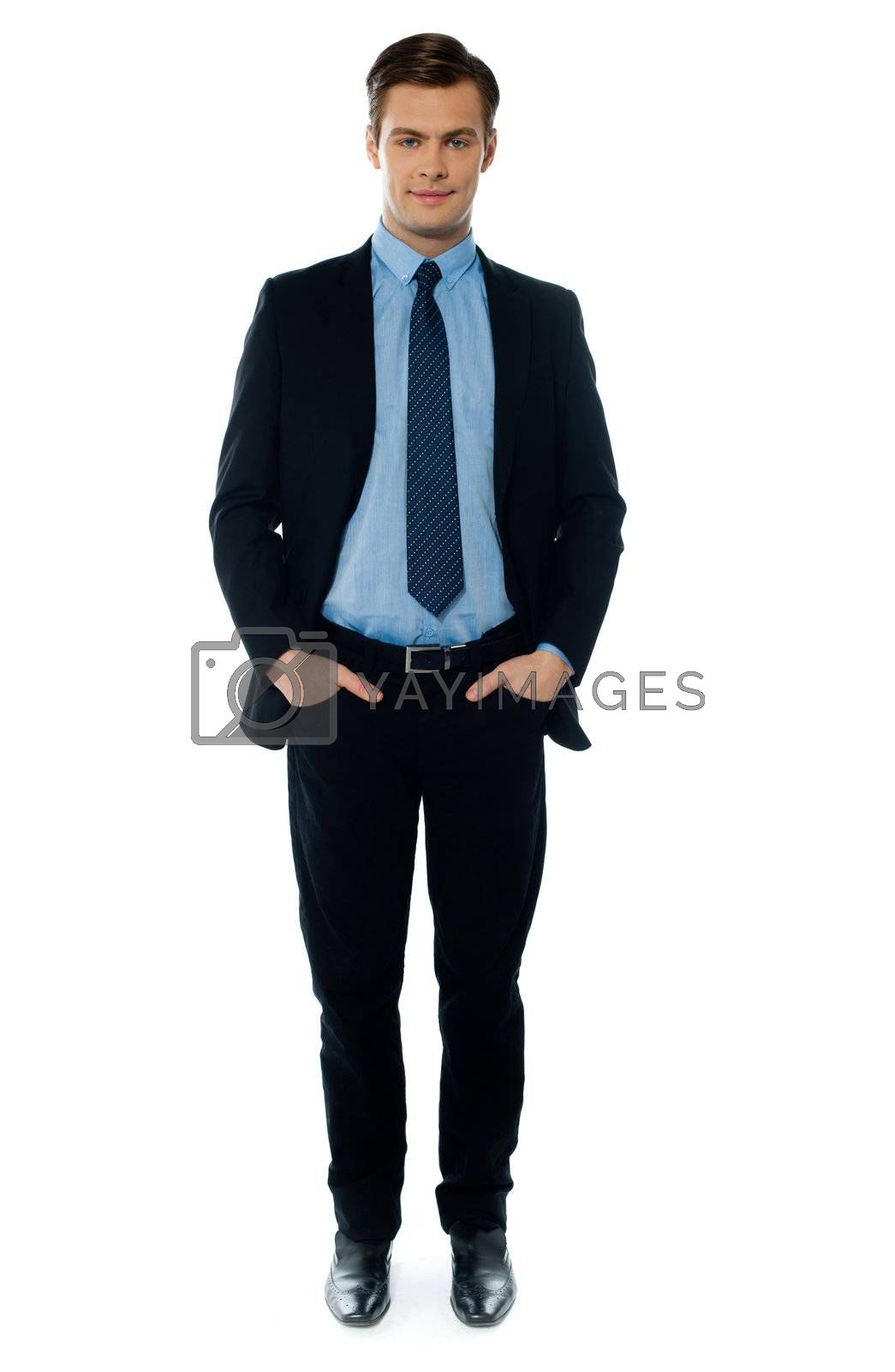 Businessman posing with hands in pocket on white background