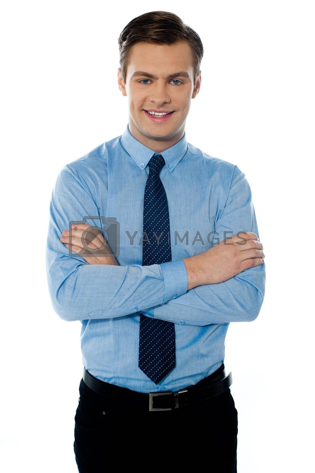 Smiling male businessman with folded arms isolated on white background