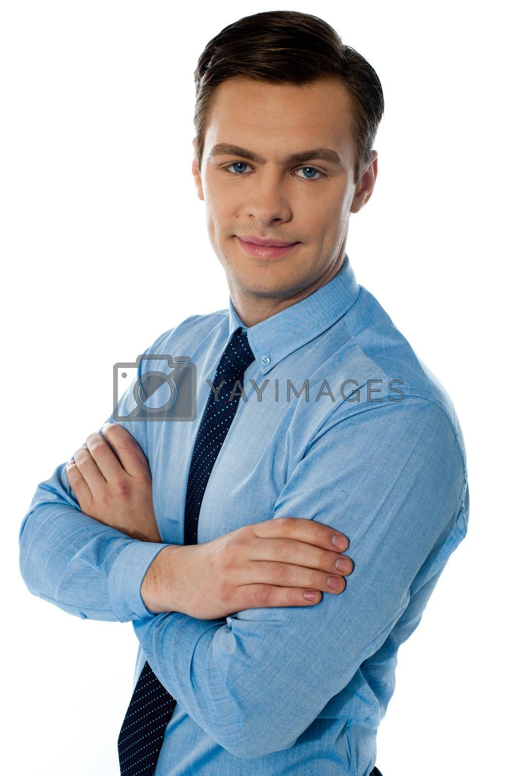 Businessman hposing with folded arms against white background