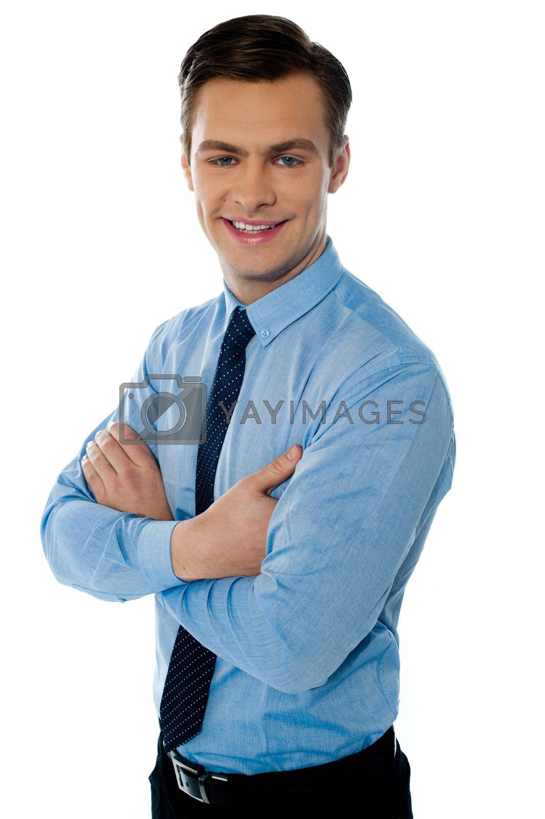 Successful businessman posing with folded arms on white background