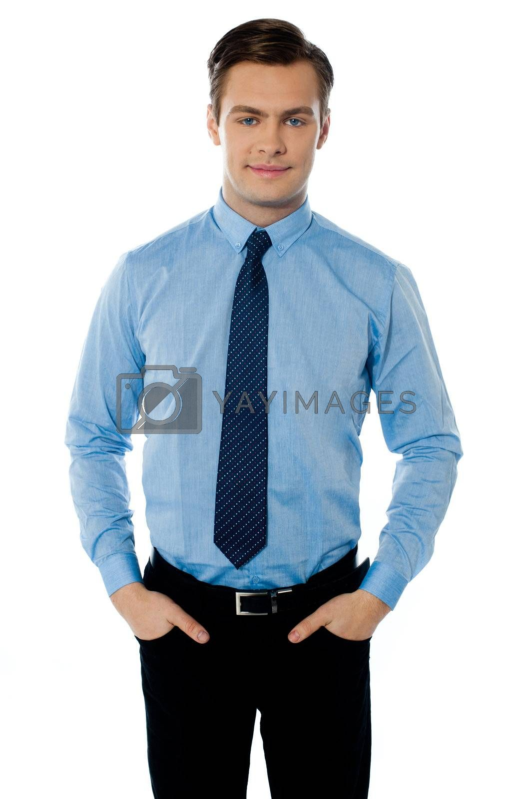 Businessman posing with hands in his pockets on white background