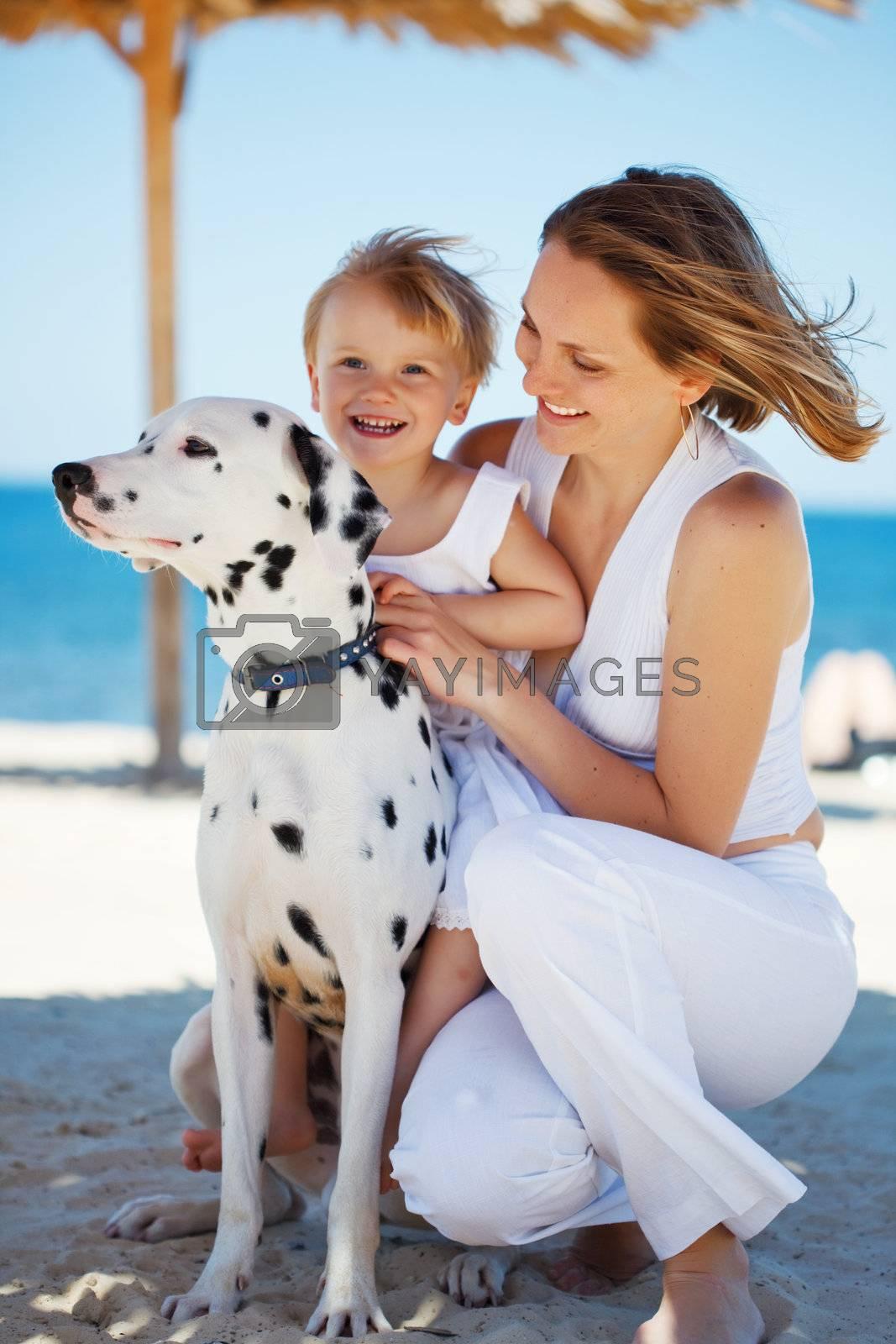 Family at beach by alenkasm