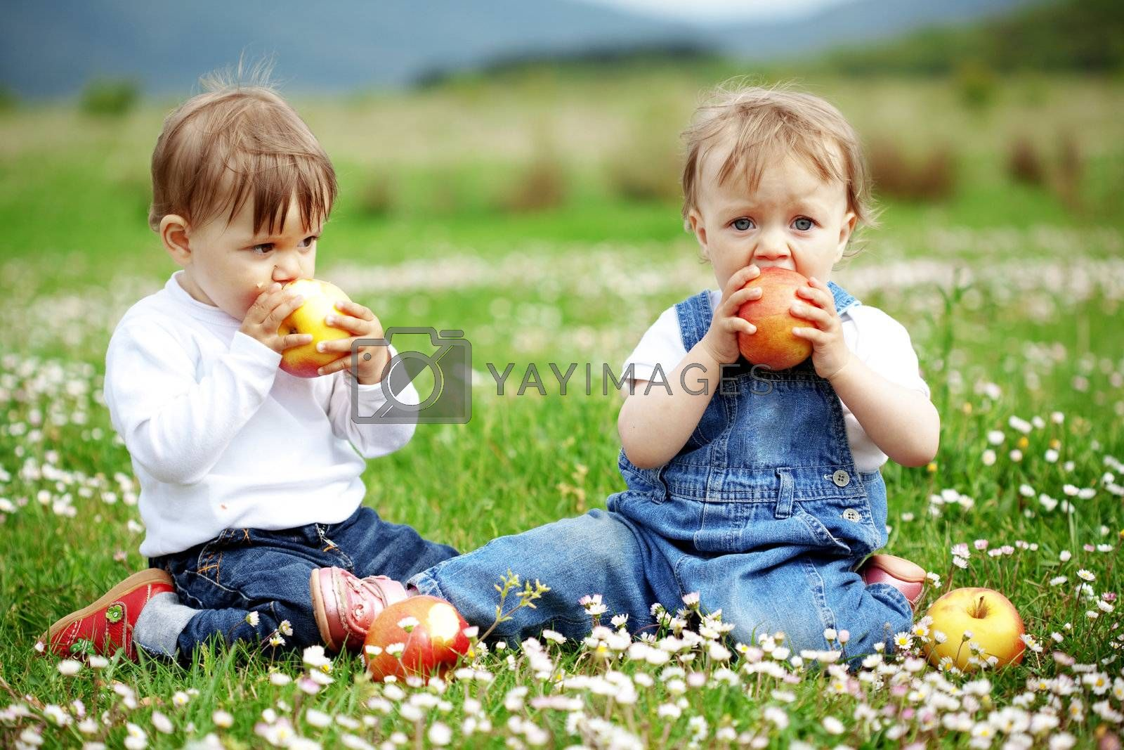 Cute happy children playing in spring filed