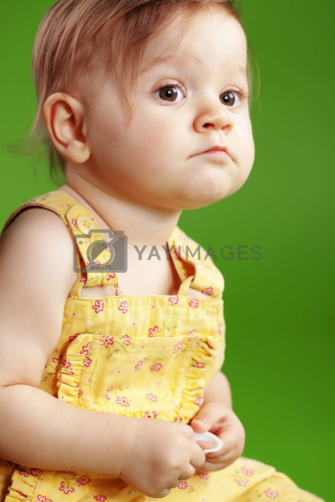 Cute baby on studio green background
