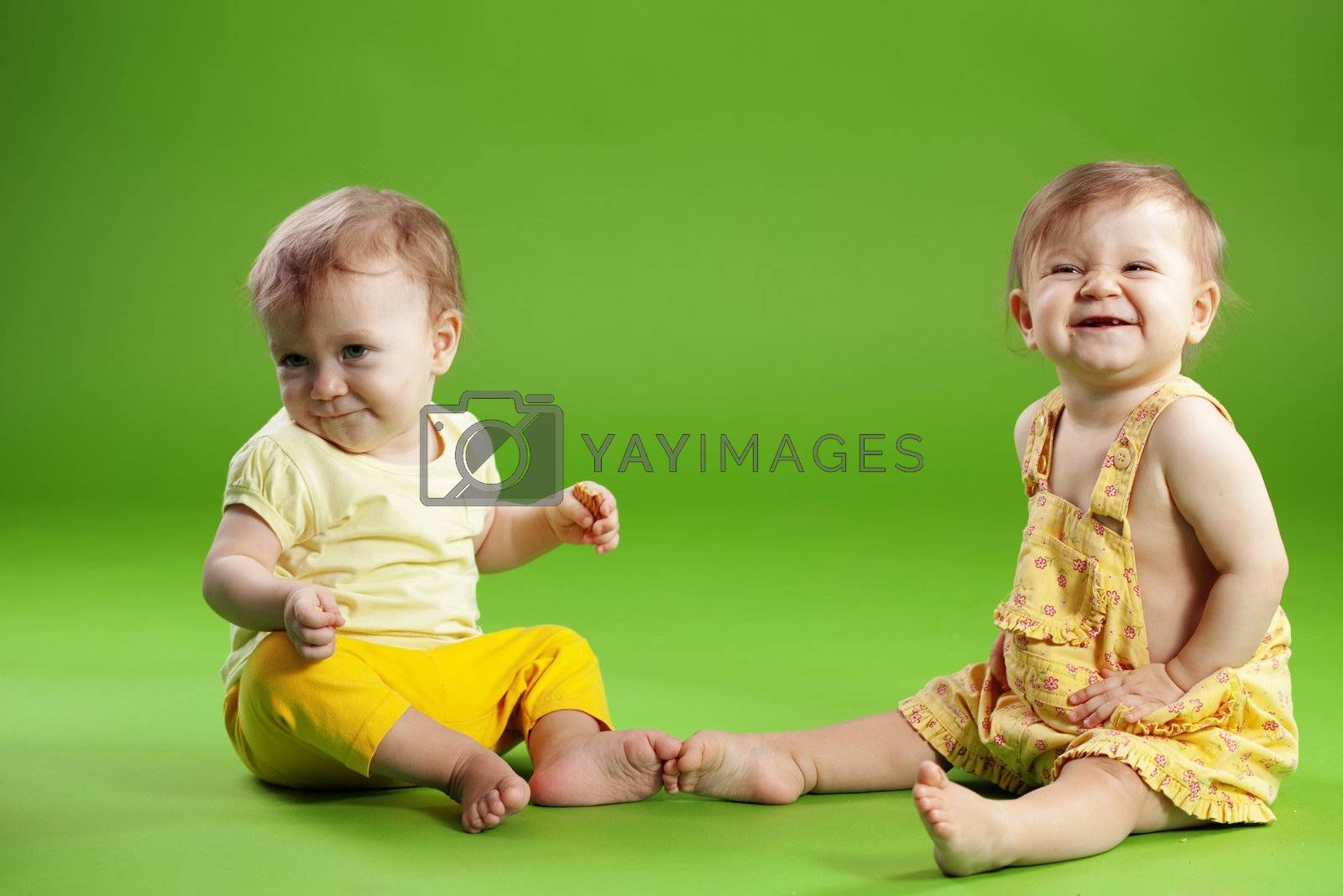 Cute babies twins over green