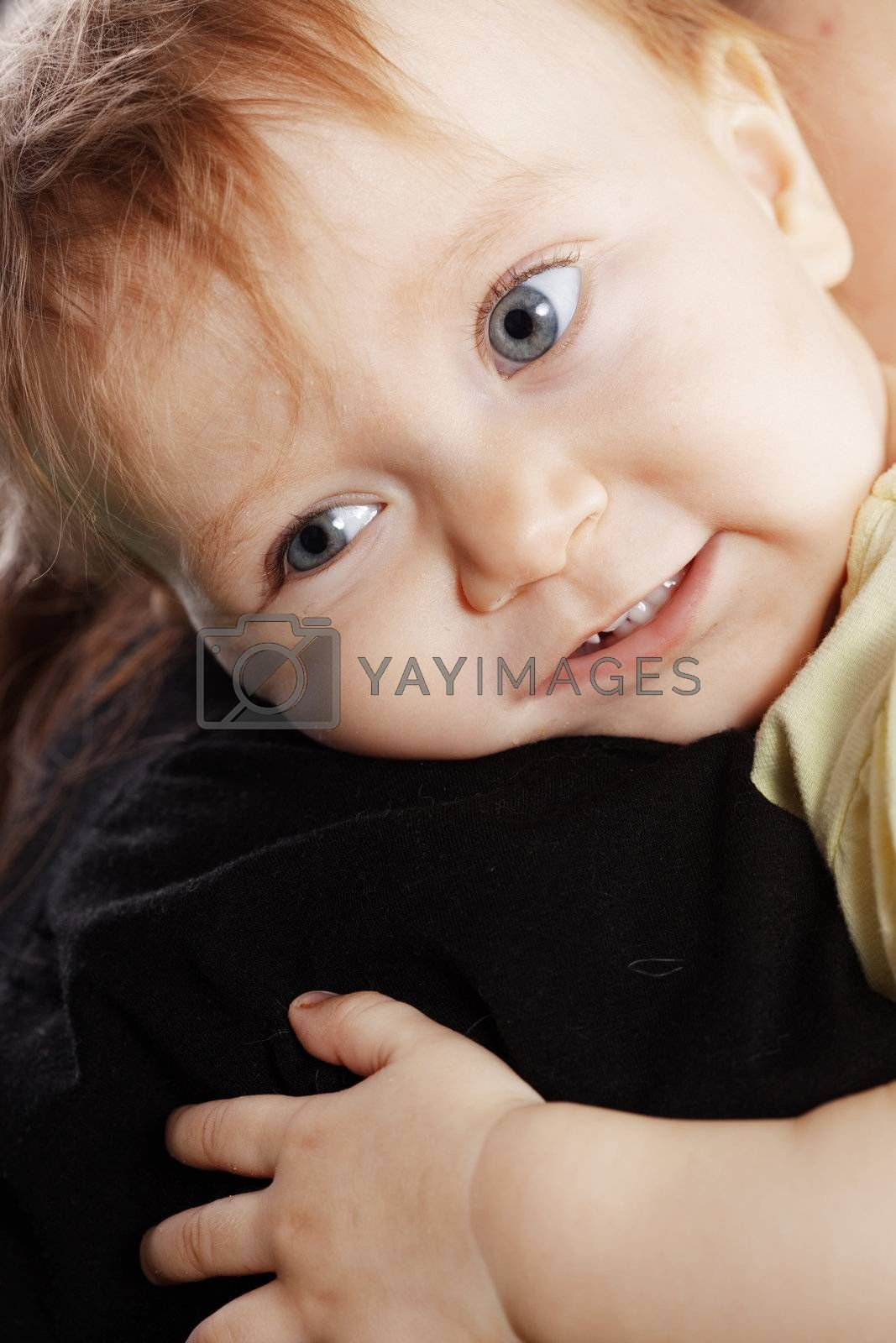 Baby lying on parent shoulder close-up