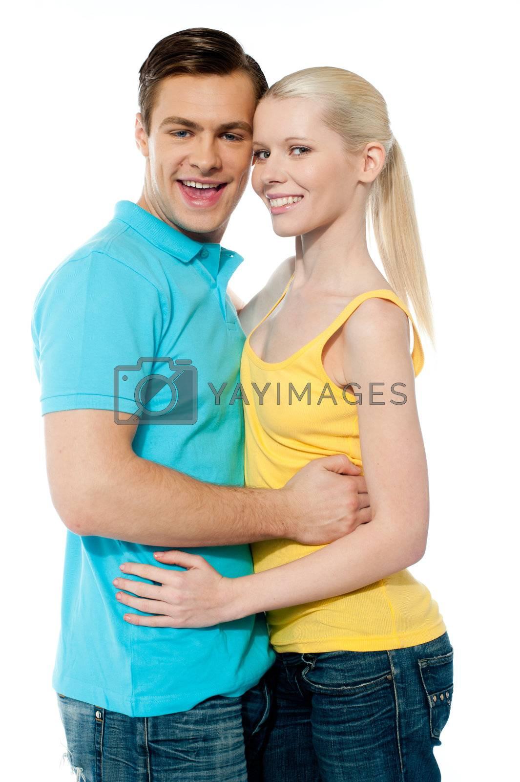 Girlfriend boyfriend hugging each other on white background