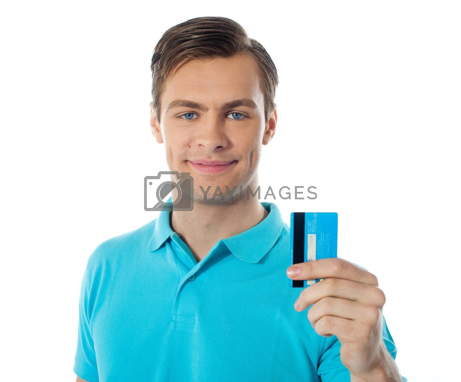 Handsome guy holding credit card and showing to camera