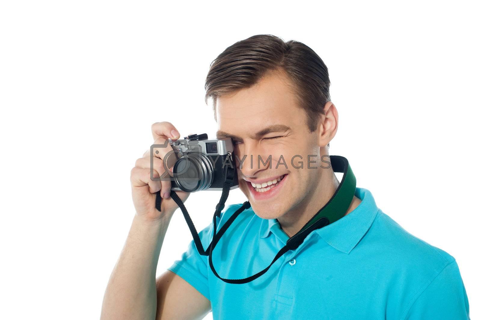 Youth photographer capturing images, studio shot
