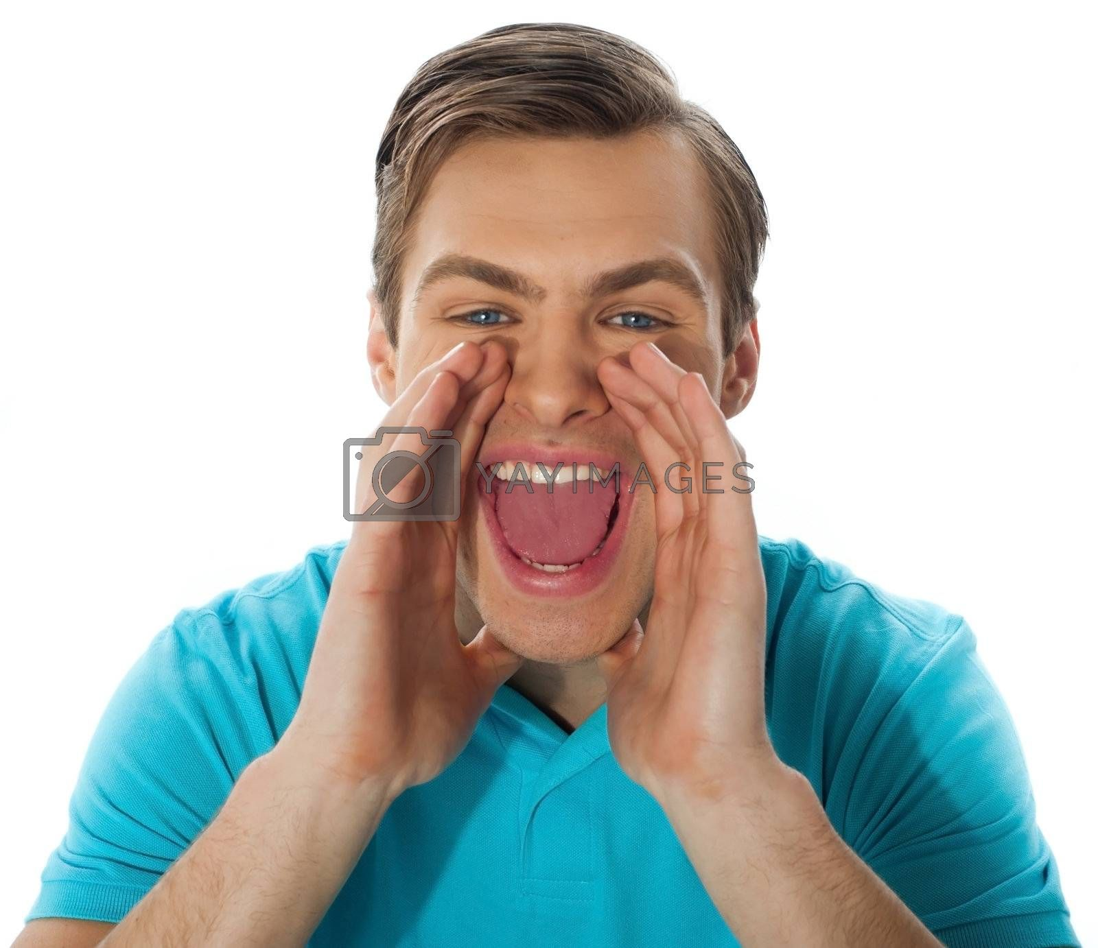 Young guy shouting loud against white background, closeup