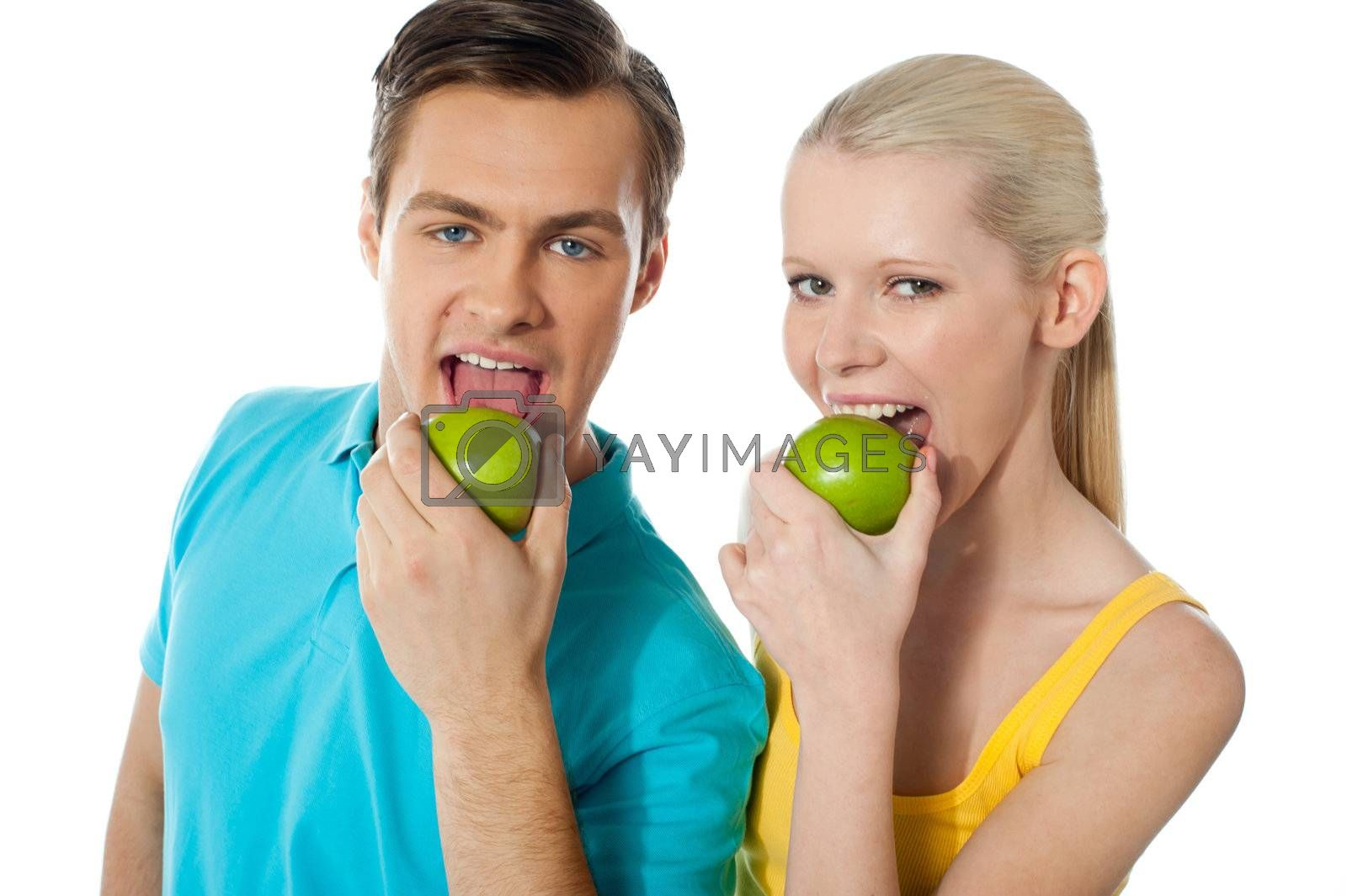 Healthy couple having fresh green apple together