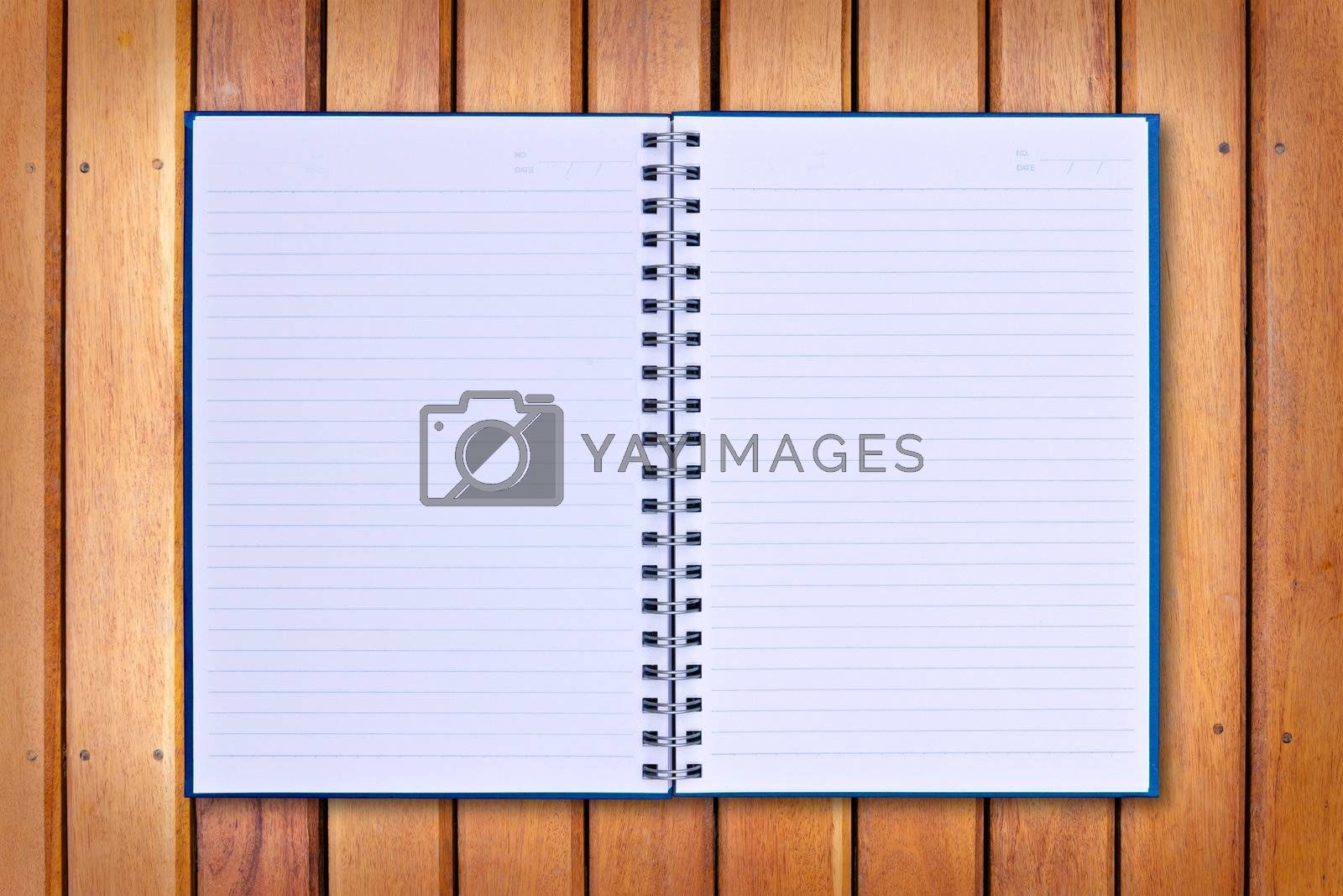 blue notebook on wood background