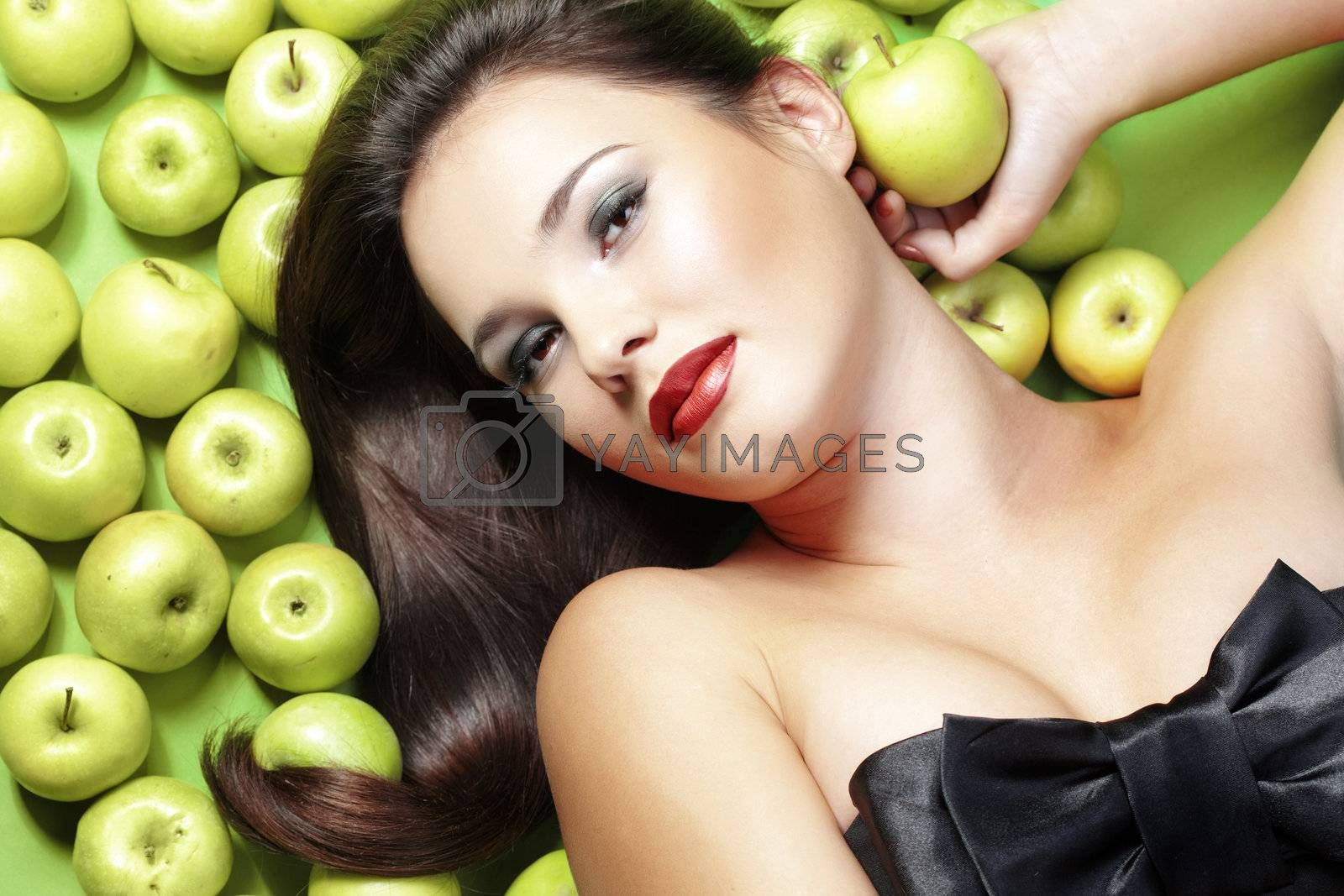 Portrait of young beautiful woman with apples
