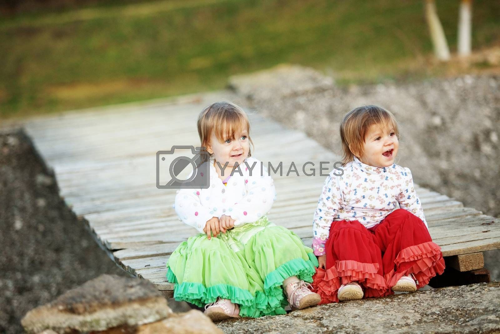 Adorable toddlers on wooden bridge