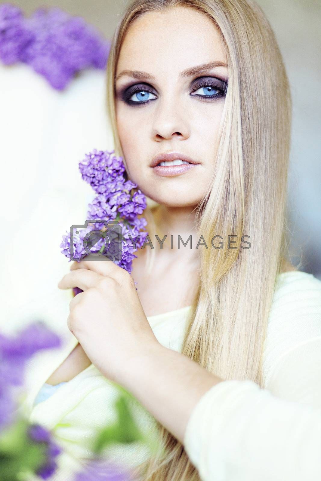 Portrait of beautiful woman with amazing blue eyes