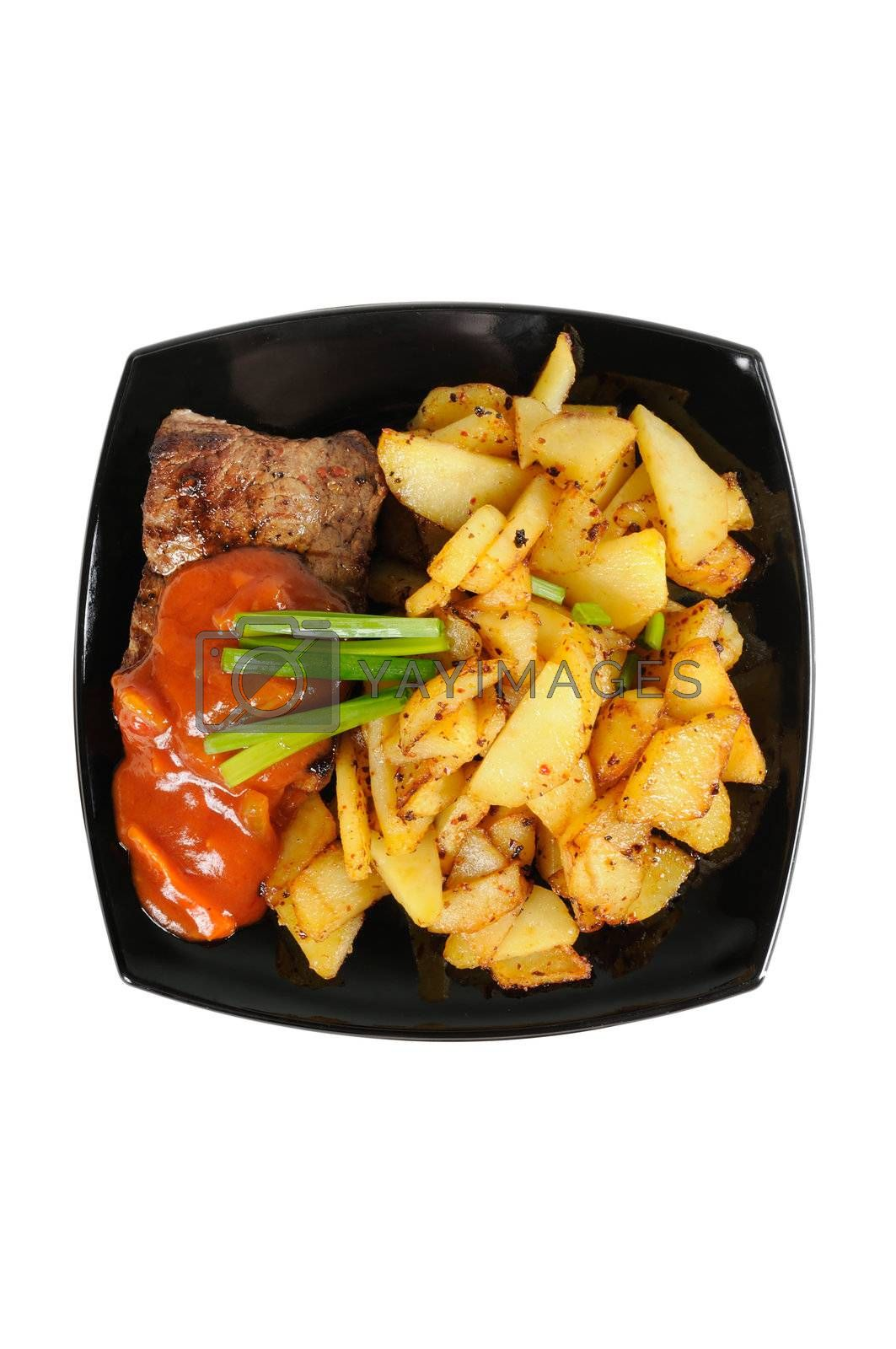 Grilled meat and  fried  potatoes  on a plate. Isolated on white.