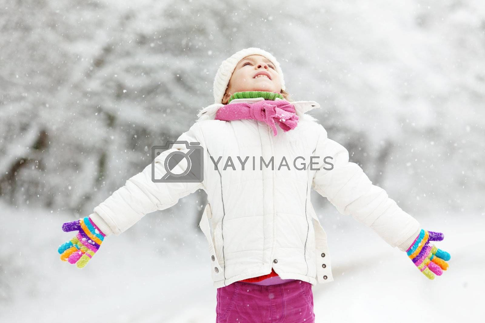 Portrait of cute little girl in winter